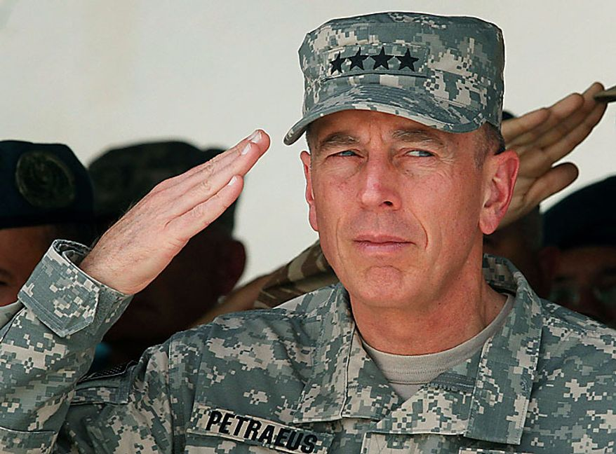U.S. Gen. David Petraeus, commander of the NATO and U.S. forces in Afghanistan, salutes during an oath-taking ceremony of recruited Afghan soldiers at the Ghazi Military Training Center, where the newcomers are being trained by Turkish military officers of the NATO-led International Security Assistance Force (ISAF) in Kabul, Afghanistan, on Thursday, July 15, 2010. (AP Photo/Musadeq Sadeq)