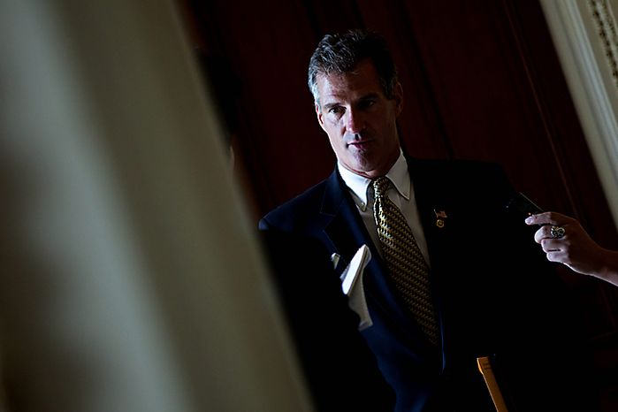 Sen. Scott Brown, R-Mass., talks to reporters on Capitol Hill in Washington, Thursday, July 15, 2010, after Congress passed the stiffest restrictions on banks and Wall Street since the Great Depression.  (AP Photo/Drew Angerer)