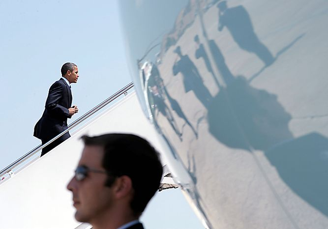 President Barack Obama walks up the steps of Air Force One at Andrews Air Force Base in Md., Thursday, July 15, 2010, on his way to participate in the groundbreaking ceremony of an advanced battery plant in Michigan. (AP Photo/Susan Walsh)