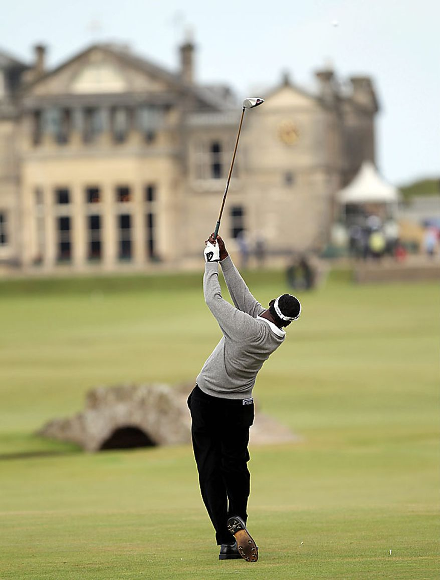 Fiji's Vijay Singh hits off the 18th tee during the first round of the British Open Golf Championship on the Old Course at St. Andrews, Scotland on Thursday, July 15, 2010. (AP Photo/Peter Morrison)