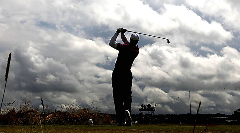 American Tiger Woods drives the ball on the 16th hole on the first day of the Open championship in St. Andrews, Scotland on July 15, 2010. (UPI/Hugo Philpott)