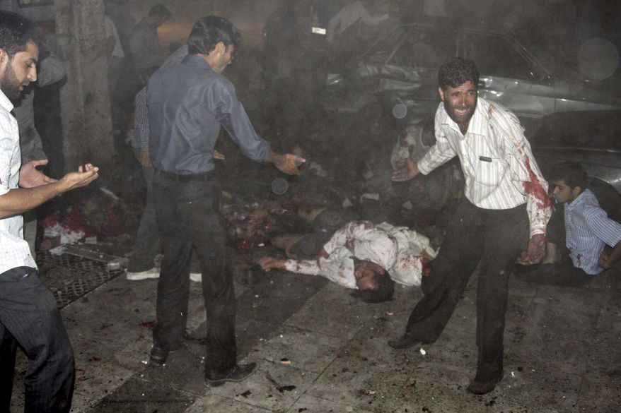 This picture released by Iran's official Islamic Republic News Agency shows the scene of the bomb blast in the city of Zahedan, 940 miles southeast of Tehran Thursday, July 15, 2010. (AP Photo/Islamic Republic News Agency, IRNA)