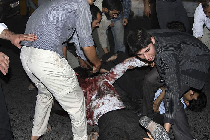 This picture released by Iran's official Islamic Republic News Agency shows the scene of the bomb blast in the city of Zahedan, 940 miles southeast of the capital Tehran Thursday, July 15, 2010. Twin bombings killed more than 20 people outside a mosque in southeastern Iran on Thursday -- including members of the powerful Revolutionary Guard -- in attacks that came less than a month after Iran hanged the leader of a militant insurgent group in the region. (AP Photo/Islamic Republic News Agency, IRNA)