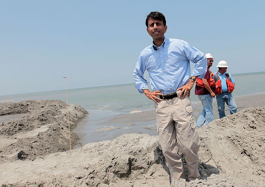 Louisiana Gov. Bobby Jindal looks over the berm system on the northern end of the Chandeleur Islands, La., Thursday, July 15, 2010. Jindal said the berm system was working to keep oil off the islands. A tightly fitted cap was successfully keeping oil from gushing into the Gulf of Mexico for the first time in three months, BP said Thursday. (AP Photo/Dave Martin)