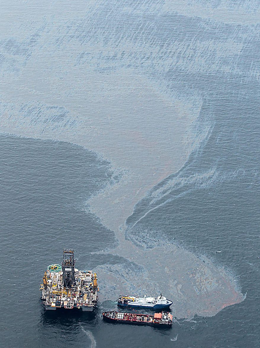Workboats operate near the Transocean Development Drilling Rig II at the site of the Deepwater Horizon incident in the Gulf of Mexico Friday, July 16, 2010. The wellhead has been capped and BP is continuing to test the integrity of the well before resuming production. (AP Photo/Dave Martin)