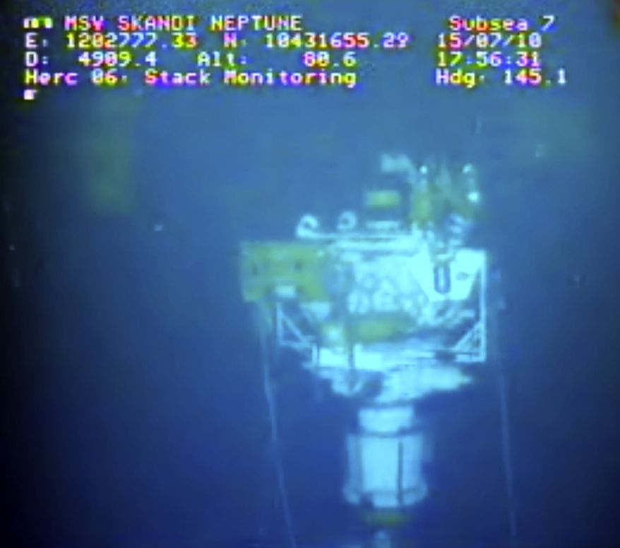 This image taken from video provided by BP PLC at 17:56 CDT shows that oil has stopped flowing from the new 75-ton cap atop the site of the Deepwater Horizon oil spill in the Gulf of Mexico Thursday, July 15, 2010. Engineers will monitor pressure gauges and watch for signs of leaks elsewhere in the well. (AP Photo/BP PLC)