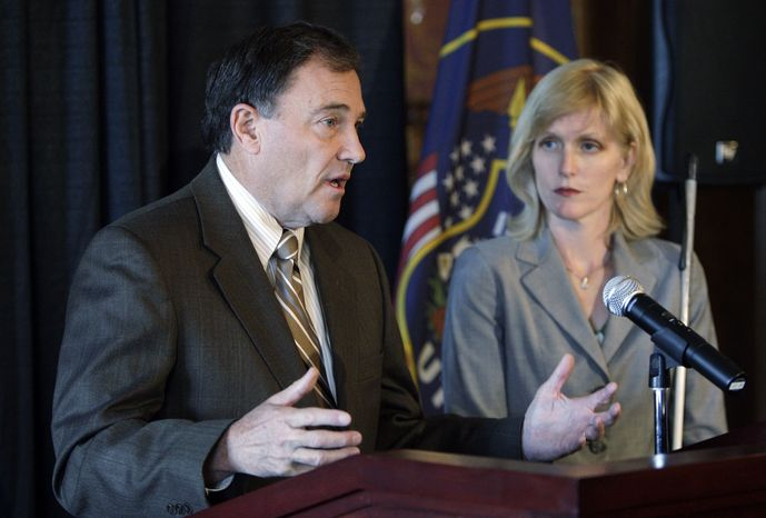 Gov. Gary R. Herbert and Kristen Cox, Executive Director of the Utah Department of Workforce Services, hold a news conference to discuss an alleged illegal immigrant list at the Utah State Capitol in Salt Lake City, Utah, Friday, July 16, 2010. Utah officials said Friday they have identified at least two state workers who apparently accessed confidential documents to create a list of 1,300 purported illegal immigrants that was mailed to law enforcement officials and the news media. (AP Photo/Deseret News, Jeffrey D. Allred)