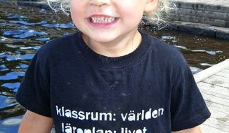"COURTESY OF THE LANTZ FAMILY Frode Lantz, who is almost 3, wears a shirt that says, ""Classroom: The World Curriculum: Life."""
