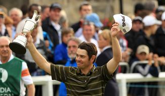 ASSOCIATED PRESS South Africa's Louis Oosthuizen holds his trophy aloft after winning the British Open Golf Championship on the Old Course at St. Andrews, Scotland, Sunday, July 18, 2010.