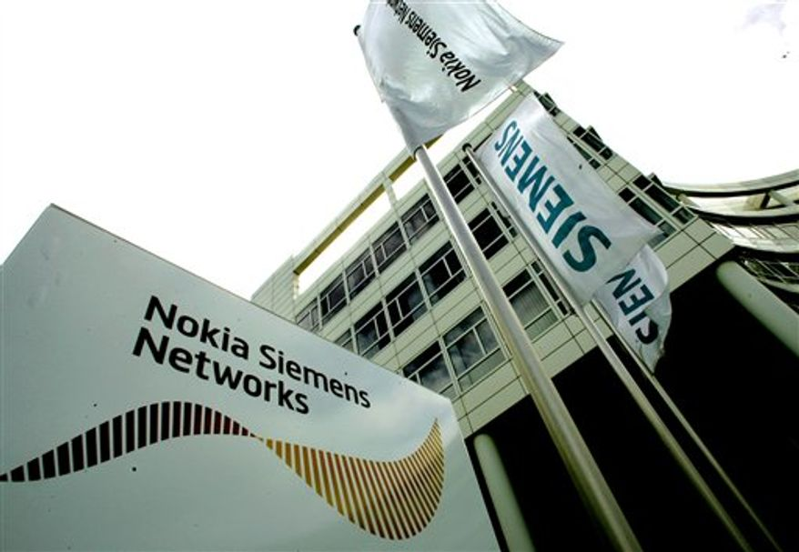 FILE - In this file photograph taken May 8, 2007, the company logo of Nokia Siemens Networks is displayed in front of the headquarters in Munich, southern Germany. Nokia Siemens Networks says it will acquire the majority of Motorola's wireless operations in a $1.2 billion deal.(AP Photo/Diether Endlicher, file)