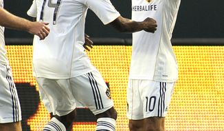 ** File ** Los Angeles Galaxy's Edson Buddle, left, celebrates his goal with teammate Landon Donovan during the first half of their soccer match against the Seattle Sounders, Sunday, July 4, 2010, in Carson, Calif. (AP Photo/Mark J. Terrill)
