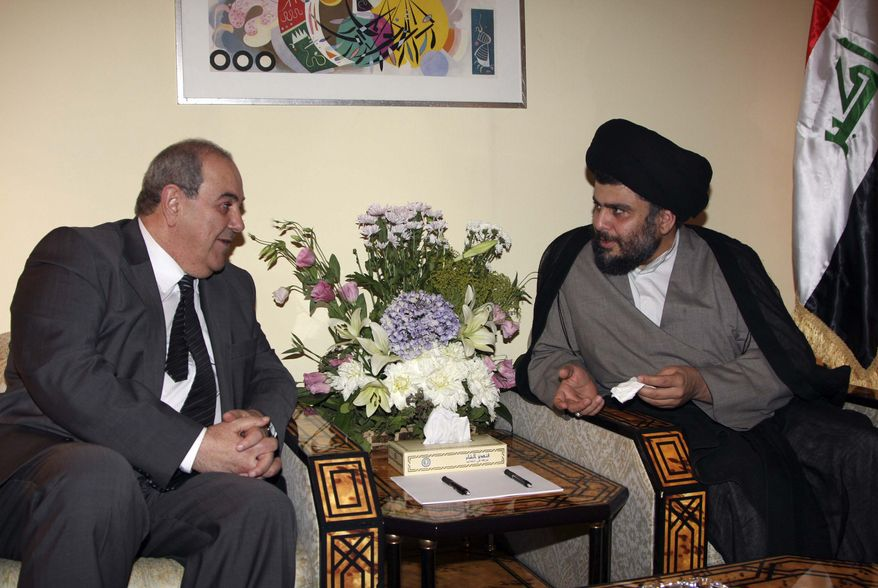 Former Iraqi Prime Minister Iyad Allawi, left, meets with Muqtada al-Sadr, one of Iraq's most powerful Shi'ite political clerics, right, in Damascus, Syria, Monday, July 19, 2010. Mr. Allawi and Mr. al-Sadr are on a current visit to Syria to discuss the deadlocked government in Baghdad.(AP Photo/Bassem Tellawi)
