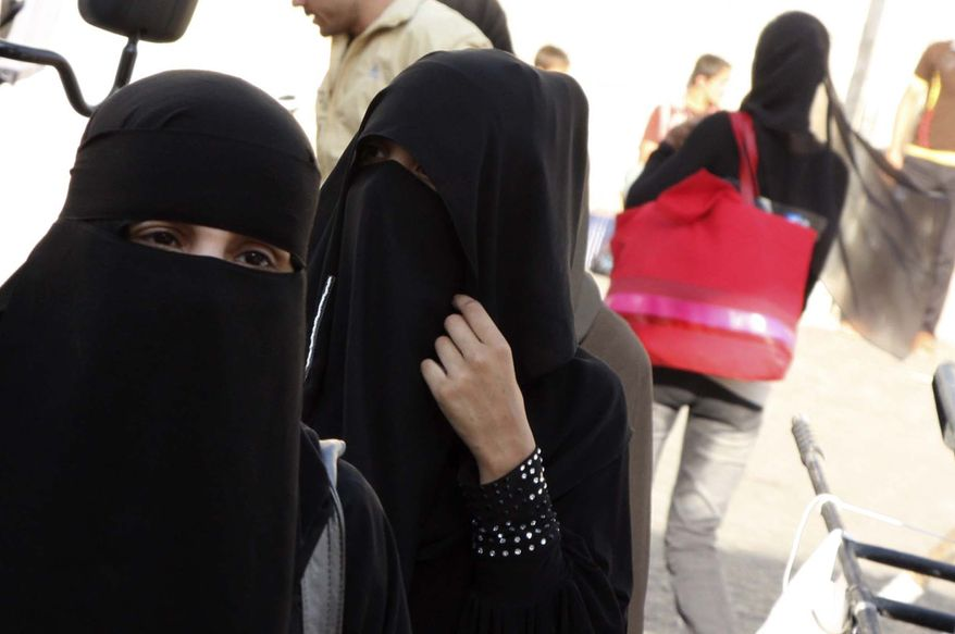 Arab women wear the niqab, a face-covering Islamic veil, as they shop in Souk Al-Hamediah, Damascus' oldest market, Syria, Monday, July 19, 2010. Syria has banned the face-covering Islamic veil from the country's universities. The Education Ministry's ban on the niqab comes as similar moves in Europe spark cries of discrimination against Muslims. An official at the ministry says the ban affects public and private universities and aims to protect Syria's secular identity. (AP Photo/Bassem Tellawi)