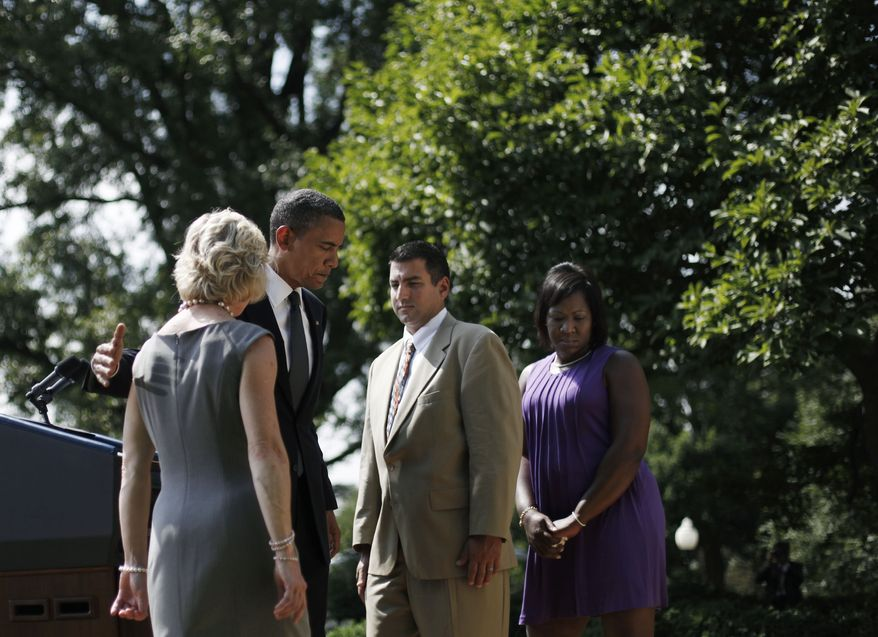 President Obama (second from left) walks from the podium in the Rose Garden of the White House with (from left) Leslie Macko of Charlottesville; Jim Chukalas of Fredon Township, N.J.; and Denise Gibson of Brooklyn, N.Y., after delivering remarks on extending unemployment insurance. (AP Photo/Pablo Martinez Monsivais)