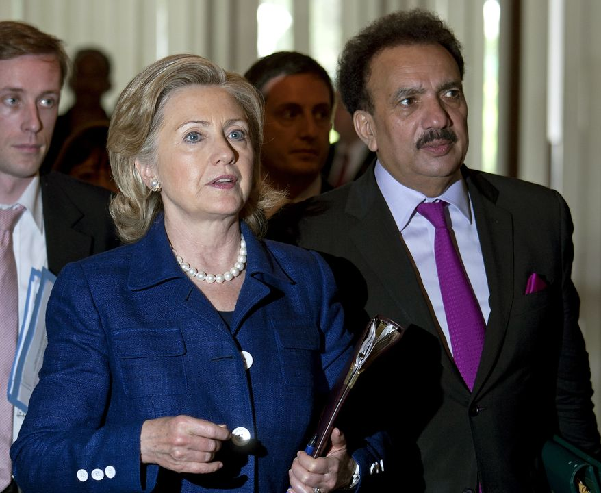 Secretary of State Hillary Rodham Clinton walks with Pakistani Interior Minister Rehman Malik (right) after their meeting in Islamabad, Pakistan, on Monday, July 19, 2010. Mrs. Clinton opened the high-level talks with Pakistan by announcing several new aid projects aimed at improving the country's water, energy and health sectors. (AP Photo/B.K. Bangash)