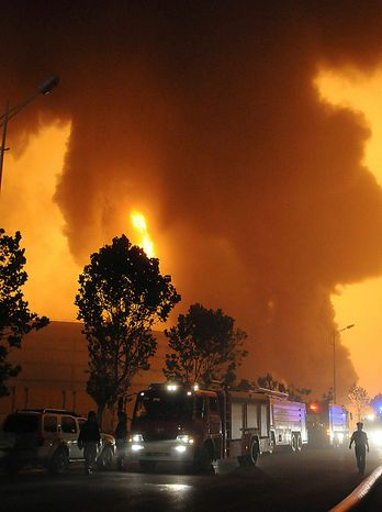 In this Friday July 16, 2010, photo released by China's Xinhua news agency, firefighters work at the oil pipeline blast site in Dalian, a port city in northeast China's Liaoning province. Xinhua said blasts hit two oil pipelines in Dalian on Friday. (AP Photo/Xinhua, Cai Yongjun)