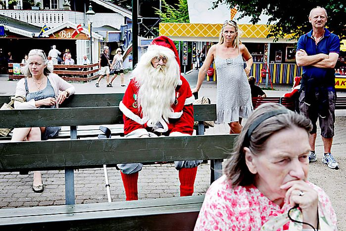 A lone Santa sits on Monday, July 19, 2010, in the Dyrehavsbakken amusement park, north of Copenhagen, Denmark, where many have gathered for the World Santa Claus Congress, which has been held 52 times now at the amusement park. Every summer, Santas from the entire world get together at Bakken to spread some Christmas cheer and have some fun. (AP Photo/Polfoto, Nanna Kreutzmann)