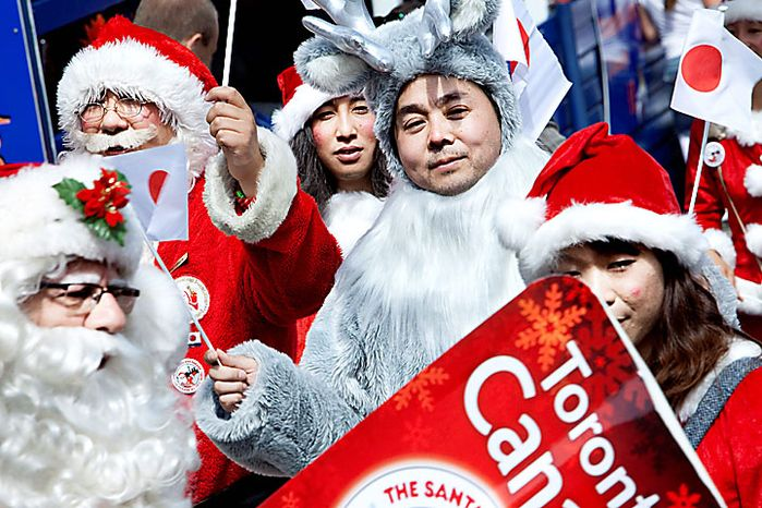 A group of Santas including a Santa and reindeer from Japan gather in the Dyrehavsbakken amusement park, north of Copenhagen, Denmark, Monday, July 19, 2010. Many have gathered for the World Santa Claus Congress, which has been held 52 times now at the amusement park. (AP Photo/Polfoto, Nanna Kreutzmann)