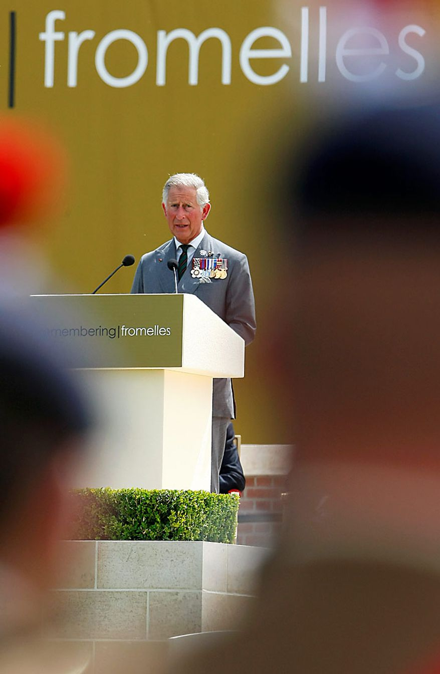 Britain's Prince Charles delivers a speech during the service of rededication at the Fromelles (Pheasant Wood) Military Cemetery, northern France, Monday, July 19, 2010. Ceremonies were marking the 94th anniversary of the World War I Battle of the Somme. (AP Photo/Michel Spingler)