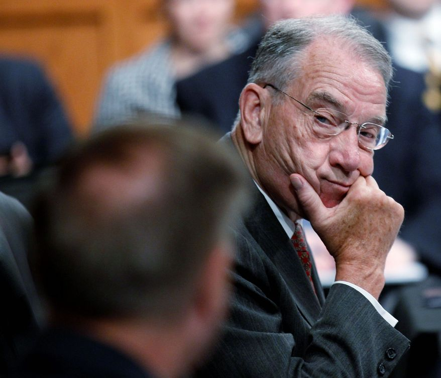 ASSOCIATED PRESS Sen. Charles E. Grassley hears out fellow Republican Lindsey Graham on Tuesday before a Judiciary Committee vote on Supreme Court nominee Elena Kagan.