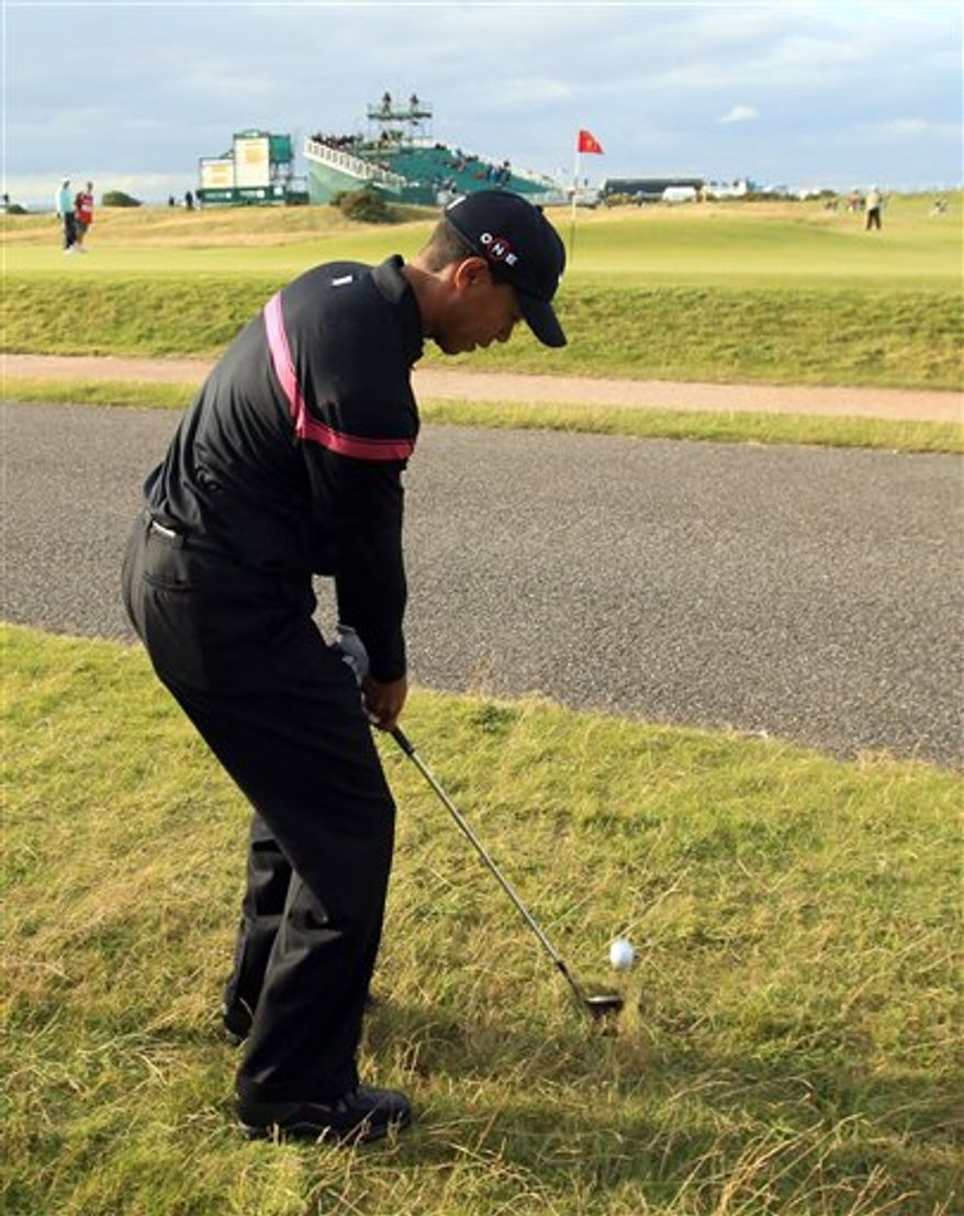 Tiger Woods of the United States chips onto the 17th green during the third round of the British Open Golf Championship on the Old Course at St. Andrews, Scotland, Saturday, July 17, 2010. (AP Photo/Jon Super)