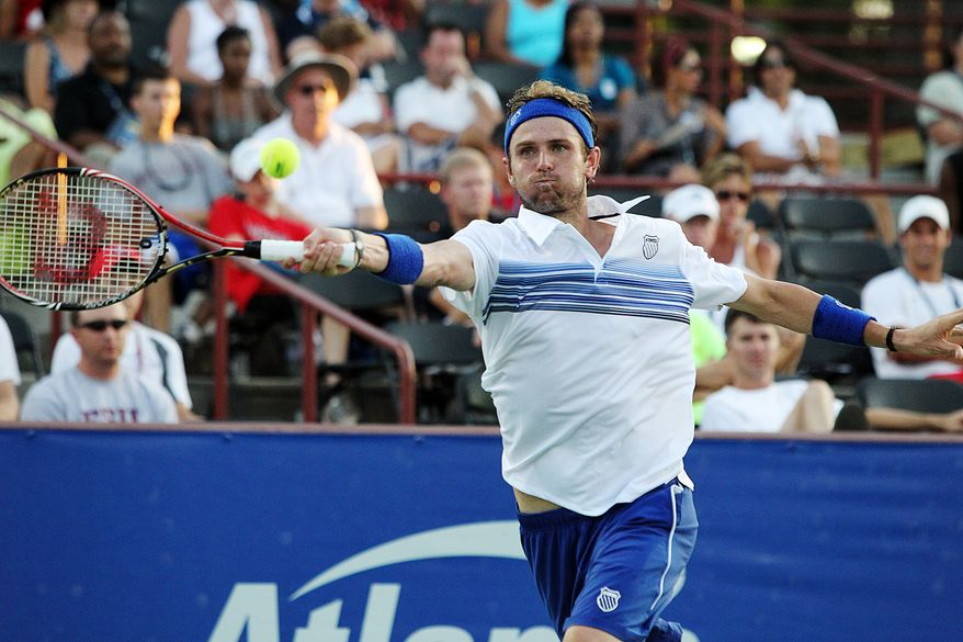 Mardy Fish, of the United States, returns a shot against James Ward, of Britain, during the first round of the Atlanta Tennis Championships at the Atlanta Athletic Club on Monday, July 19, 2010, in Atlanta. (AP Photo/Atlanta Journal Constitution, Curtis Compton)