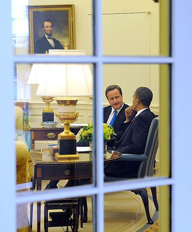 Britain's Prime Minister, David Cameron, left, during his meeting with President Barack Obama in the Oval Office at the White House in Washington, Tuesday, July 20, 2010. (AP Photo/PA, Stefan Rousseau)