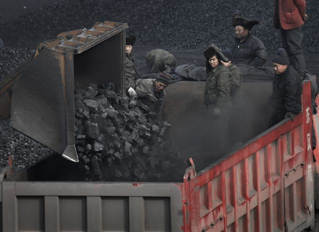In this Dec. 3, 2009, file photo, workers load coal into a truck outside a coal mine in Dadong, Shanxi province, China. China has overtaken the United States as the world's largest energy consumer, the International Energy Agency said Tuesday, July 20, 2010. China immediately questioned the calculation. (AP Photo/Andy Wong, File)