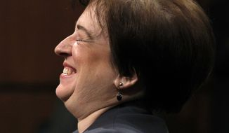 Supreme Court nominee Elena Kagan laughs on Capitol Hill in Washington, Tuesday, June 29, 2010, while testifying before the Senate Judiciary Committee hearing on her nomination. The committee approved her nomination on Tuesday, July 20. (AP Photo/Alex Brandon)
