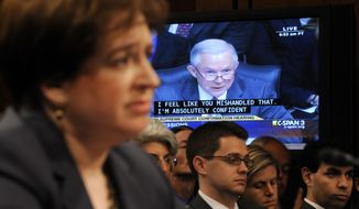 ** FILE ** Supreme Court nominee Elena Kagan (foreground) listens to questions from Sen. Jeff Sessions (pictured on a video screen), Alabama Republican, who is the ranking Republican on the Senate Judiciary Committee, on Capitol Hill in Washington on Tuesday, June 29, 2010, during Ms. Kagan's confirmation hearing. (AP Photo/Susan Walsh)
