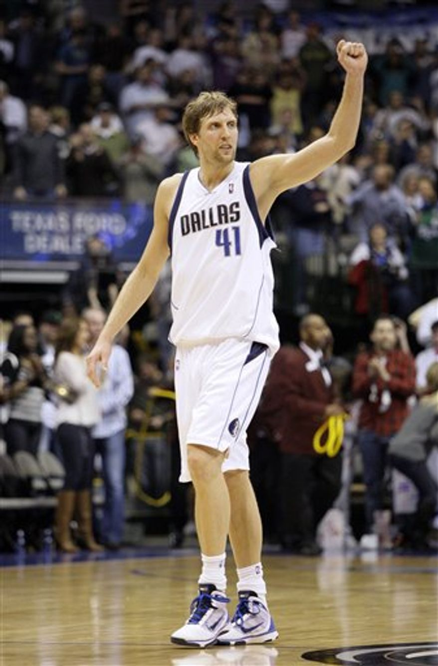FILE - In this March 5, 2010, file photo, Dallas Mavericks forward Dirk Nowitzki, of Germany, acknowledges cheers from fans following an NBA basketball game against the Sacramento Kings in Dallas. The Mavericks announced Monday, July 19, 2010, that Nowitzki has signed a new contract with team. The agreement was reached earlier in the month. (AP Photo/Tony Gutierrez, File)