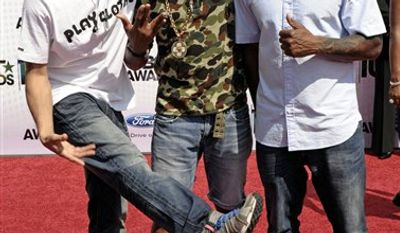 FILE - In this June 27, 2010 file photo, from left, Shay Haley, Pharrell Williams and Chad Hugo of N.E.R.D. arrive at the BET Awards in Los Angeles. (AP Photo/Dan Steinberg, file)