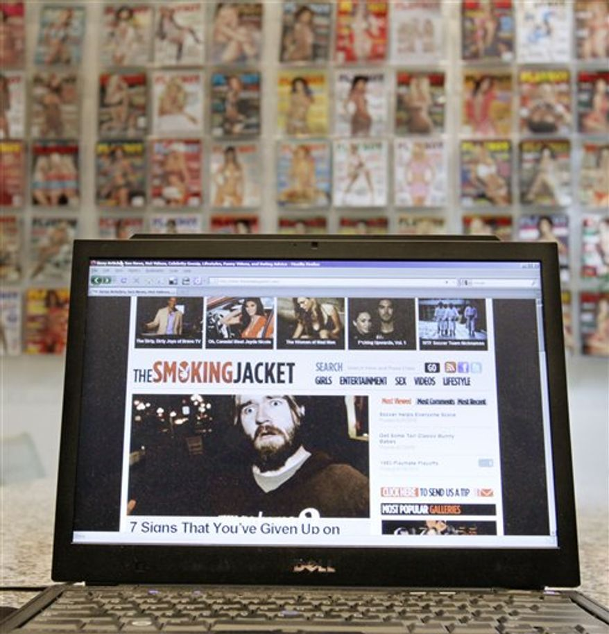 In this photo taken July 15, 2010, a laptop displays the web site the smokingjacket.com, produced by Playboy Enterprises at the company headquarters in Chicago. Playboy says the web site is safe to look at while at work _ welcome news for men tired of throwing themselves over their computer screens whenever the boss walks by. (AP Photo/M. Spencer Green)