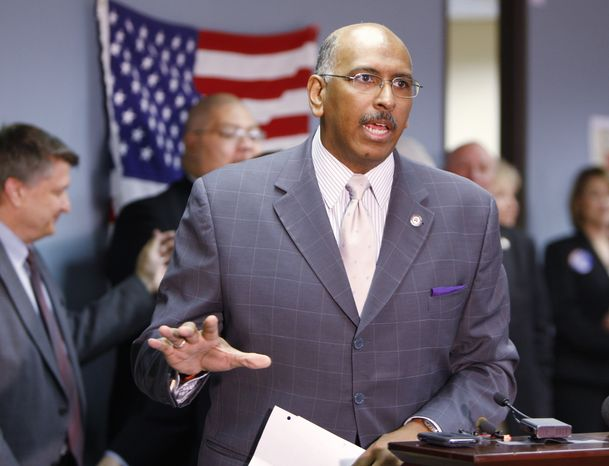 ASSOCIATED PRESS Republican Party chairman Michael Steele, center, talks with Republican state leaders and volunteers during a visit to the Colorado GOP headquarters in the Greenwood Village south of Denver on Thursday, July 8, 2010.