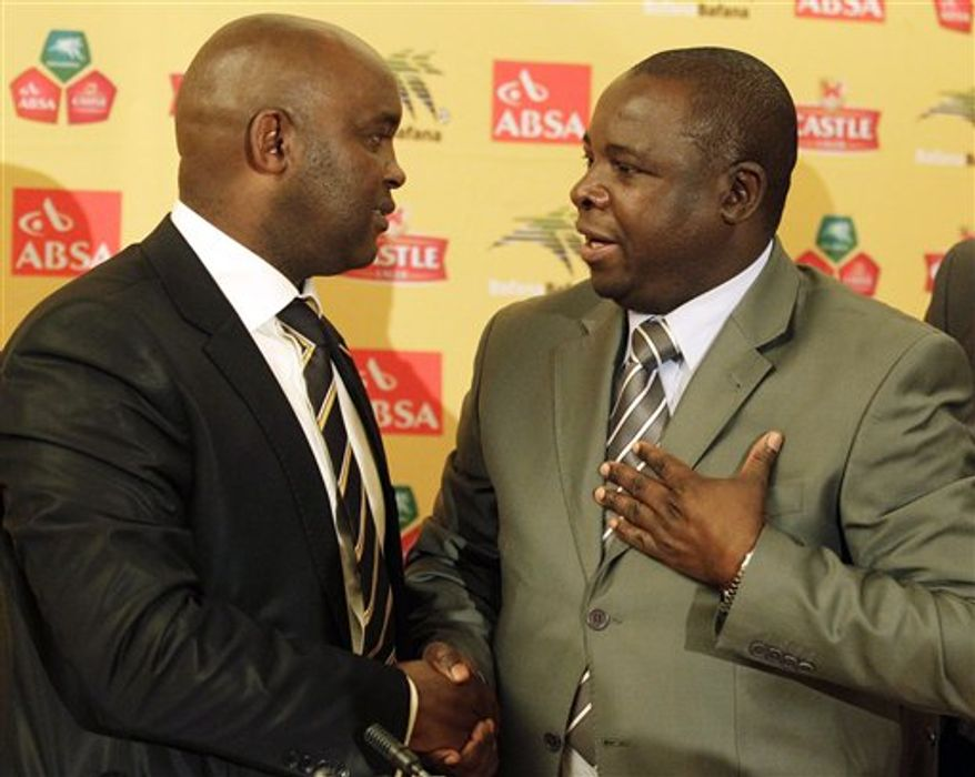 Kirsten Nematandani, president for South African Football Association, right, shakes hand with newly appointed coach for South Africa's national soocer team Pitso Mosimane, in Johannesburg, South Africa, Thursday July 15, 2010. (AP Photo/Themba Hadebe)