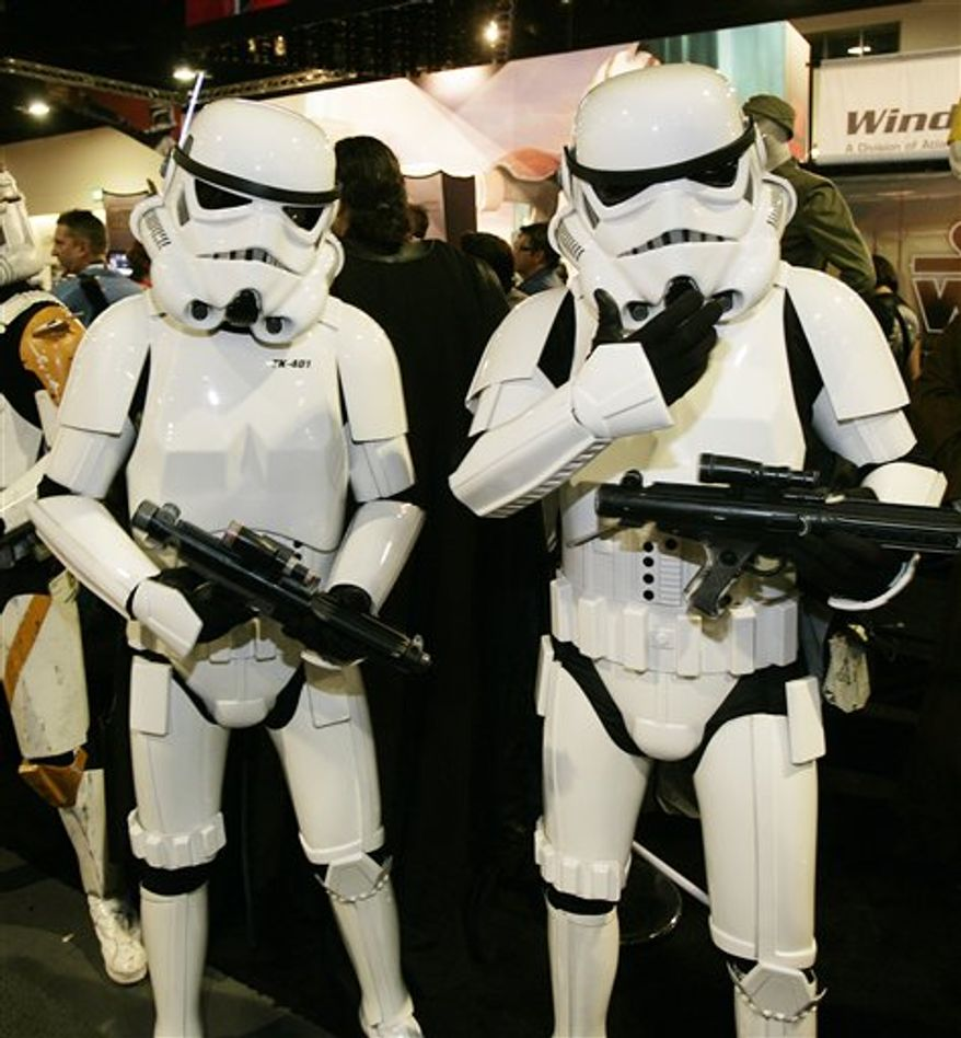 In this July 24, 2009 photo, two Comic-Con attendees dressed as Star Wars Storm Troopers pose for a photo at Comic-Con in San Diego.  (AP Photo/Denis Poroy)