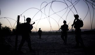 U.S. Army soldiers from the 1-320th Alpha Battery, 2nd Brigade of the 101st Airborne Division arrive at COB Nolan after a foot patrol, in the volatile Arghandab Valley, Kandahar, Afghanistan, Tuesday, July 20, 2010. (AP Photo/Rodrigo Abd)
