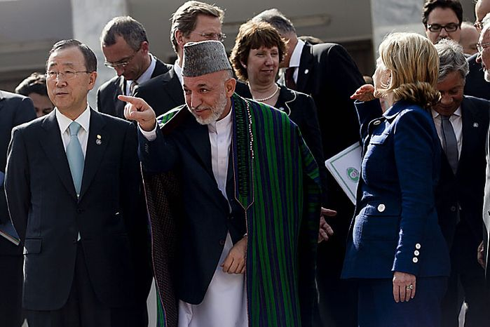 (Front row, from L to R) U.N. Secretary General Ban Ki Moon, Afghan President Hamid Karzai, and U.S. Secretary of State Hillary Clinton pose for photos in Kabul on July 20, 2010. A major international conference in Kabul ended on July 20 calling for at least 50 percent of development aid for the country to be channeled through the Afghan government's budget within two years.  UPI/Hossein Fatemi