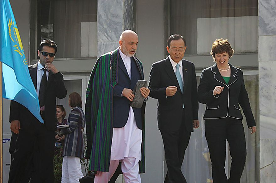 Afghan President Hamid Karzai, left, walks with U.N. Secretary General Ban Ki-moon, center, and Catherine Ashton, the European Union foreign policy minister, right, to a group photo after an international conference at the Foreign Ministry in Kabul, Afghanistan on Tuesday, July 20, 2010. (AP Photo/Musadeq Sadeq)