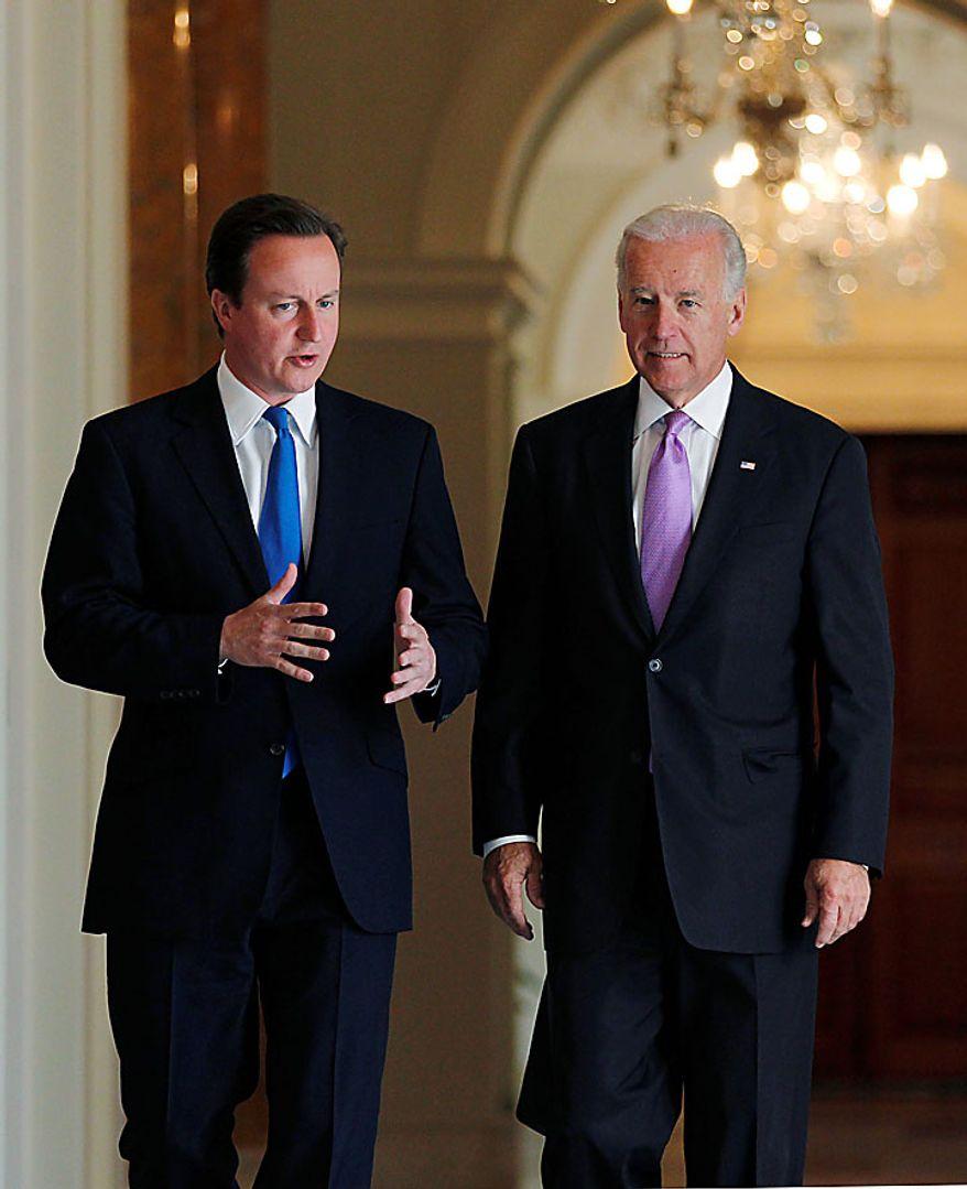 British Prime Minister David Cameron, left, hosts a breakfast meeting with Vice President Joe Biden at the British Embassy in Washington, Tuesday, July 20, 2010. (AP Photo/J. Scott Applewhite)
