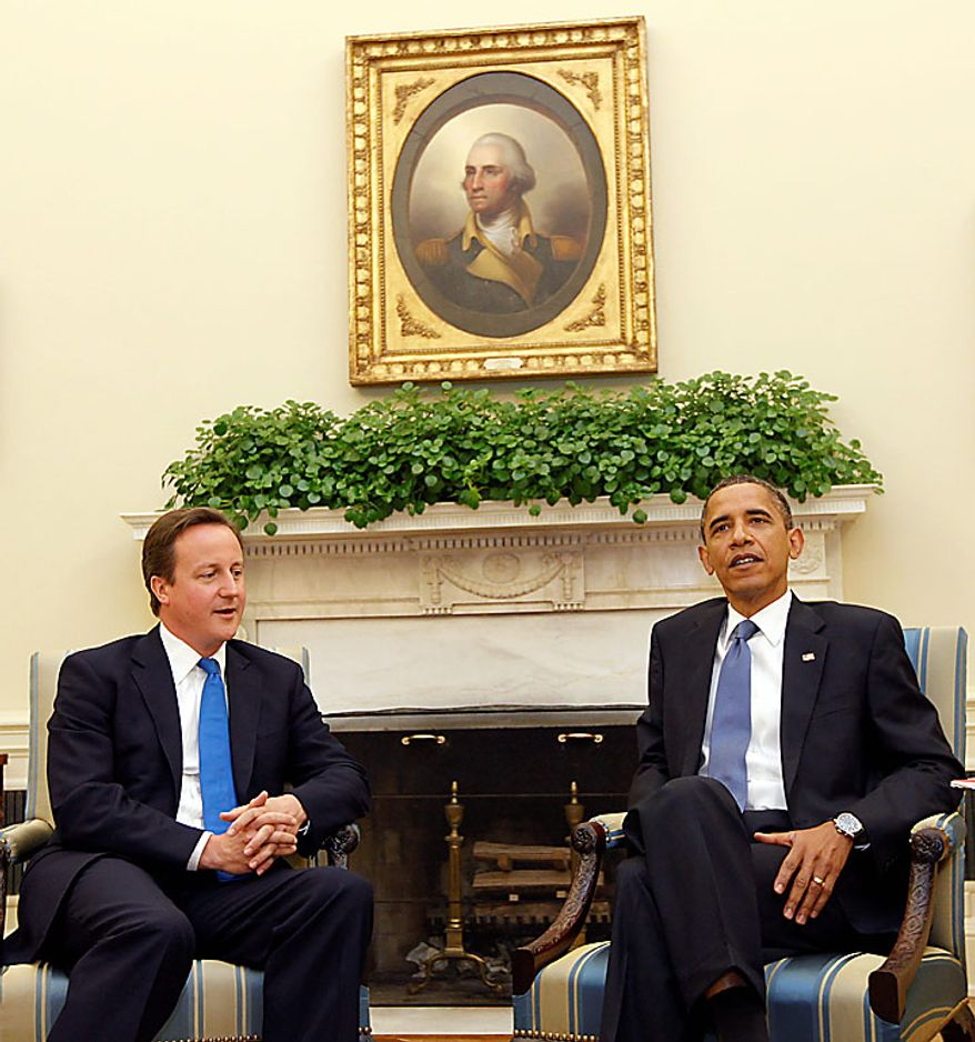 President Barack Obama, right, and British Prime Minister David Cameron, left, talk during their meeting in the Oval Office of the White House in Washington Tuesday, July 20, 2010. (AP Photo/Pablo Martinez Monsivais)