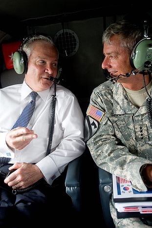 "A photo provided by the Defense Department shows Defense Secretary Robert M. Gates, left, speaking to Army Gen. Walter L. ""Skip"" Sharp, commander of U.S. Combined Forces Command and commander of U.S. Forces Korea, on board a helicopter to Camp Casey in South Korea to speak with U.S. and Korean troops, Tuesday July 20, 2010. (AP Photo/Cherie Cullen)"