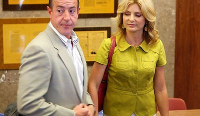 Michael Lohan, father of Lindsay Lohan, and attorney Lisa Bloom arrive at the Beverly Hills courthouse, Tuesday, July 20, 2010, where Lindsay was taken into custody to begin serving her jail sentence for a probation violation. (AP Photo/Reed Saxon)