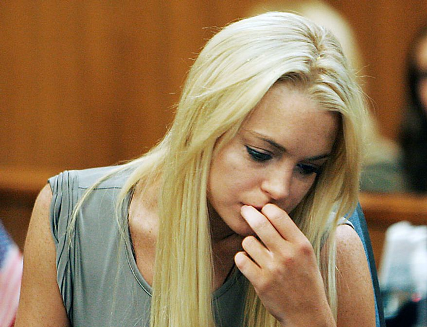 Actress Lindsay Lohan is shown in a courtroom on Tuesday, July 20, 2010, in Beverly Hills, Calif., where she was taken into custody to serve a jail sentence for a probation violation. (AP Photo/Al Seib, Pool)