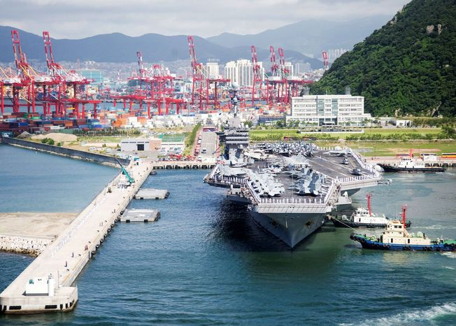 ** FILE ** The aircraft carrier USS George Washington arrives in Busan, South Korea, in July 2010 to take part in four days of joint naval exercises with South Korea. (Navy Visual News Service via Associated Press)