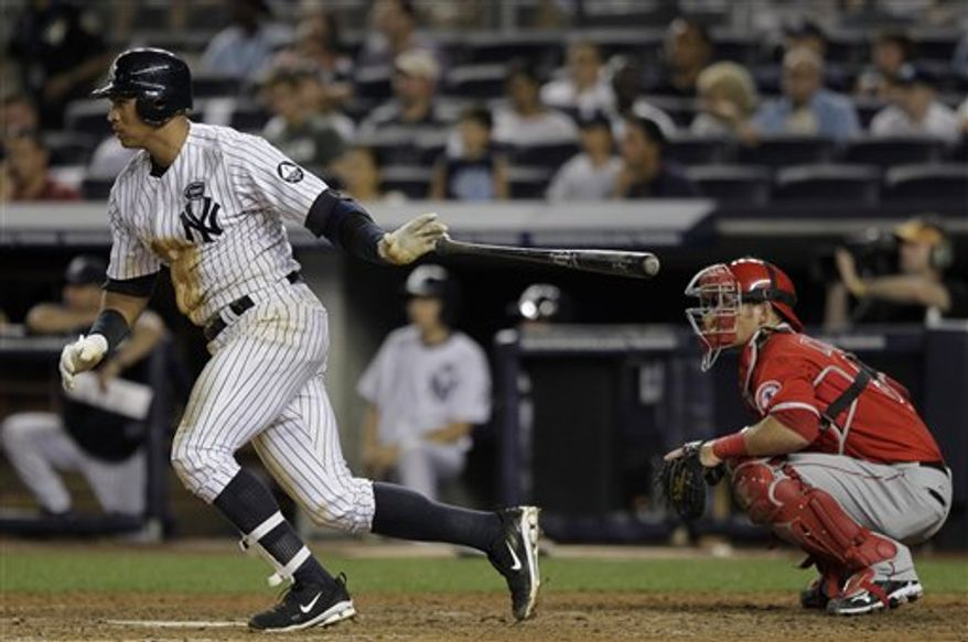 New York Yankees' Alex Rodriguez follows through on a base hit as Los Angeles Angels catcher Jeff Mathis looks on in the eighth inning of a baseball game Tuesday, July 20, 2010, at Yankee Stadium in New York. (AP Photo/Julie Jacobson)
