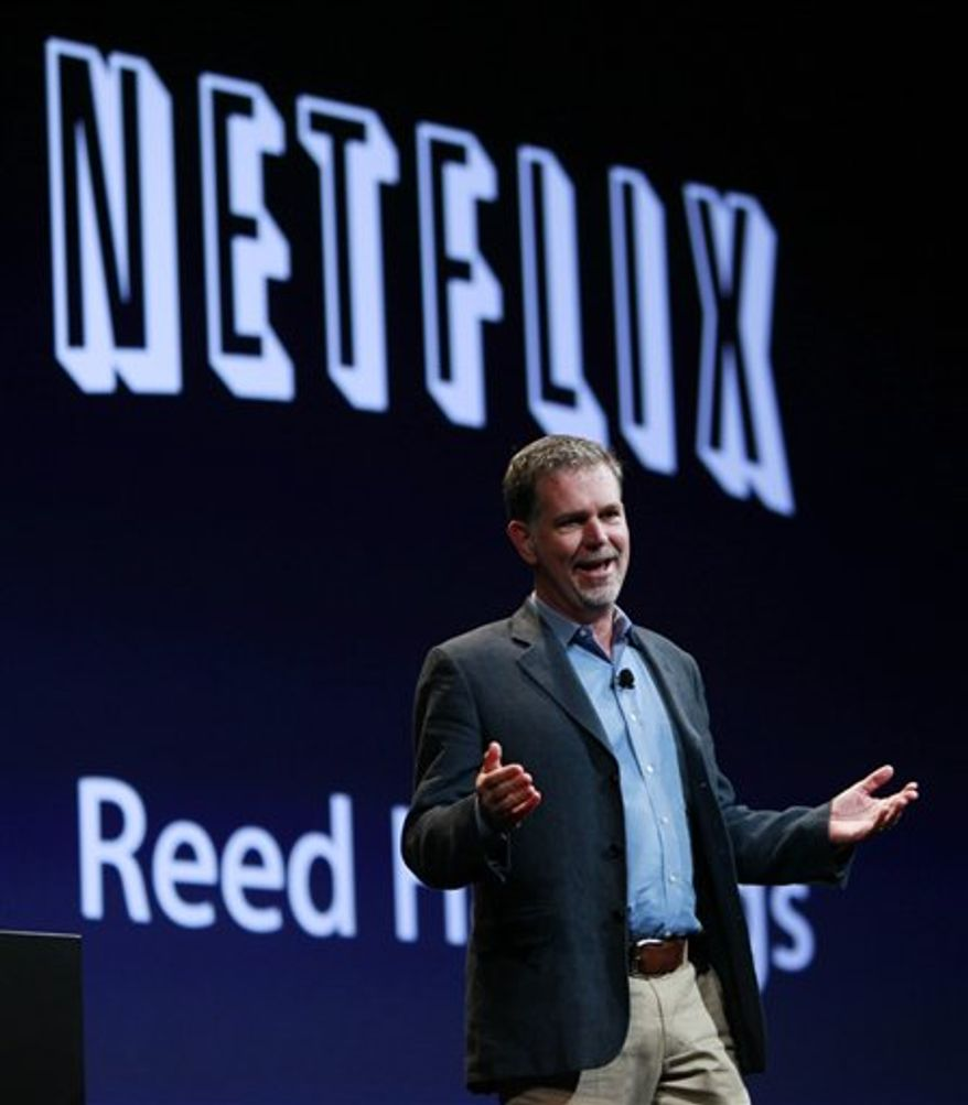 FILE - In this June 7, 2010 file photo, Netflix CEO Reed Hastings greets the audience at the Apple Worldwide Developers Conference, in San Francisco. Netflix Inc., releases second-quarter earnings Wednesday, July 21, 2010, after the market close. (AP Photo/Paul Sakuma, file)