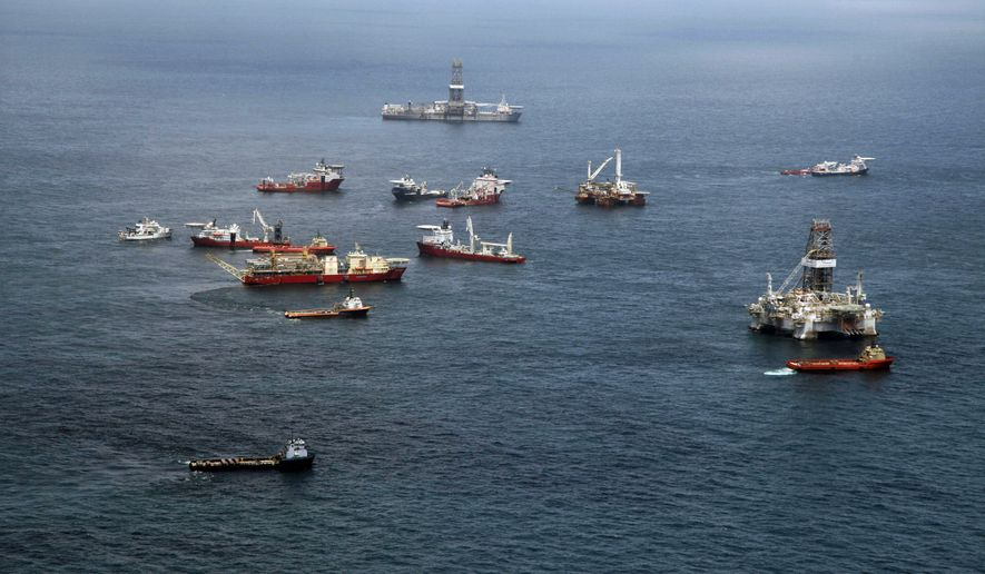 Vessels gather at the Deepwater Horizon oil spill site off the Louisiana coast in the Gulf of Mexico on Tuesday, July 20, 2010. (AP Photo/Gerald Herbert)