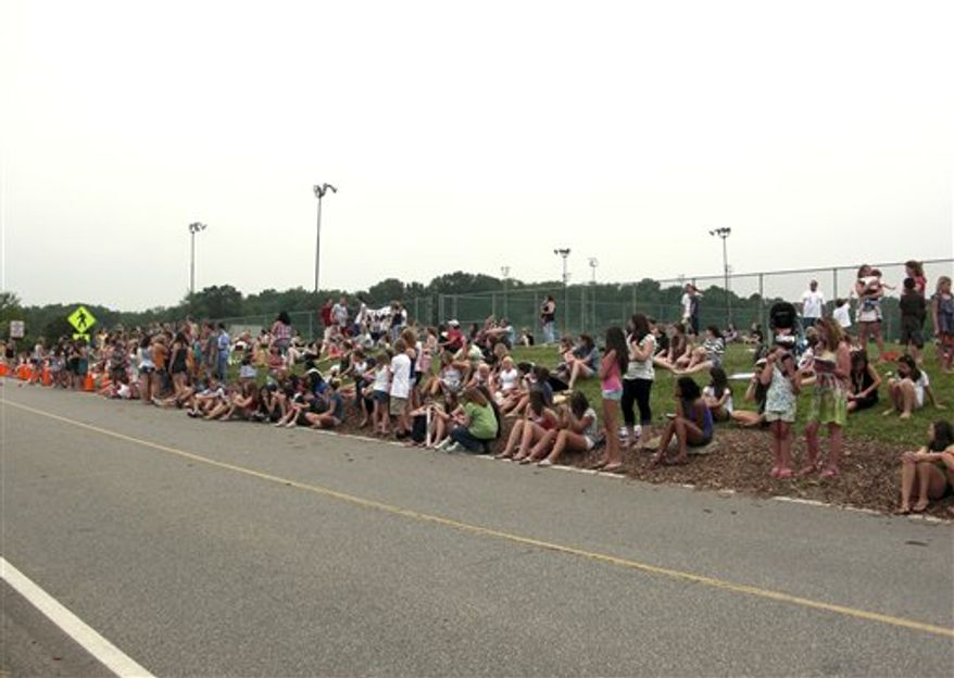 This July 13, 2010 photo provided by Melissa Rayworth shows people lining a road to try to get a glimpse of actor Taylor Lautner at Hampton High School in Allison Park, Pa. The rumors started last spring. Girls at Hampton High School gathered around their lockers, debating whether it could be true: Was heartthrob Taylor Lautner actually coming to their school to shoot a movie?     (AP Photo/Melissa Rayworth)   NO SALES