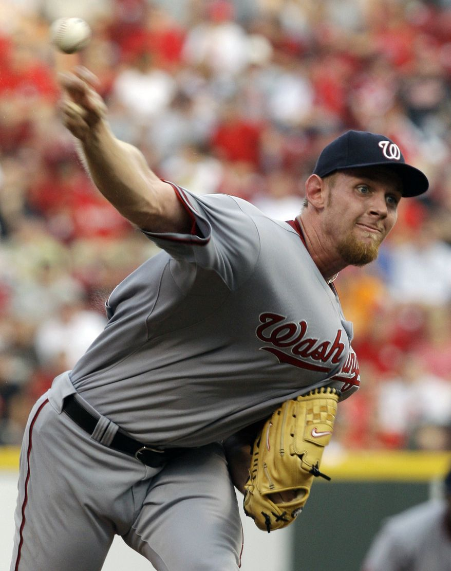 ASSOCIATED PRESS Washington Nationals starting pitcher Stephen Strasburg throws against the Cincinnati Reds in the first inning of a baseball game, Wednesday, July 21, 2010, in Cincinnati.